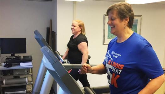 Participants in Neha Gothe's study use treadmills