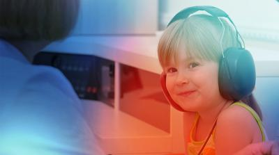 Image of a child doing a hearing test