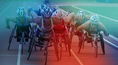 Image of 7 wheelchair track athletes racing