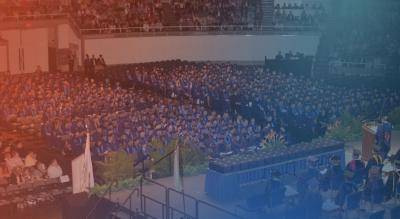 Commencement ceremony for 1,500 students in blue caps and gowns